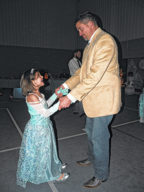 Fathers, daughters dance again