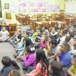 Hobbton student launches book drive, receives visit from Atkinson