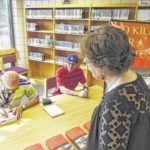 SCC instructor Gravis signs book